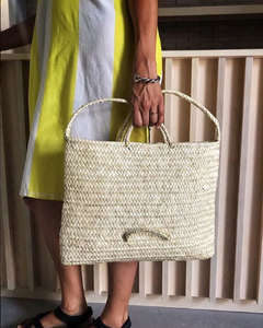 """María in her delicious organic bakery """"Rustic"""" with her Antic Mallorca bag."""
