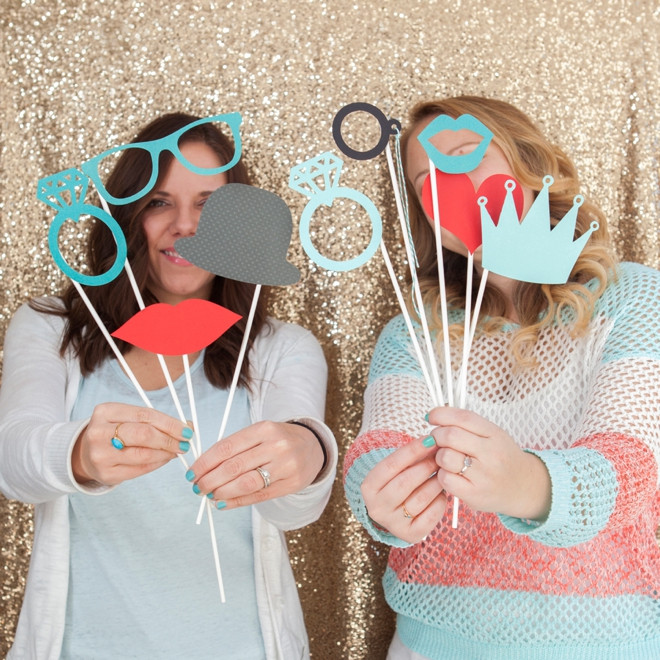 Custom PhotoSnap Props with two women on a golden sequin backdrop