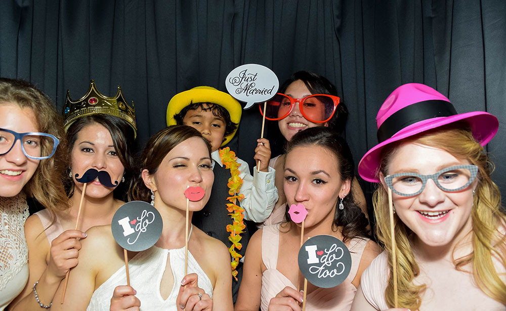 Wedding Party enjoying PhotoSnap Photo Booths in Columbus Ohio with funny props
