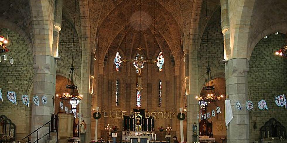 Zingen tijdens advent in de kerk van Schimmert