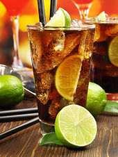 Cuba Libre Cocktail on wooden Background
