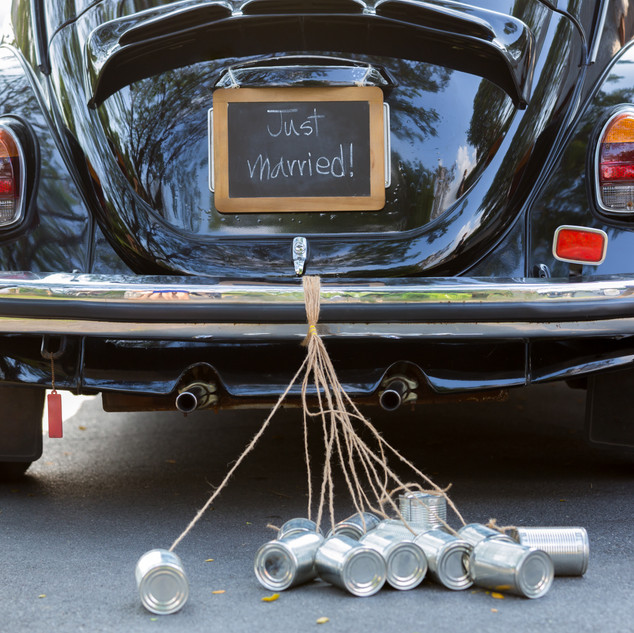 Vintage wedding car with just married si
