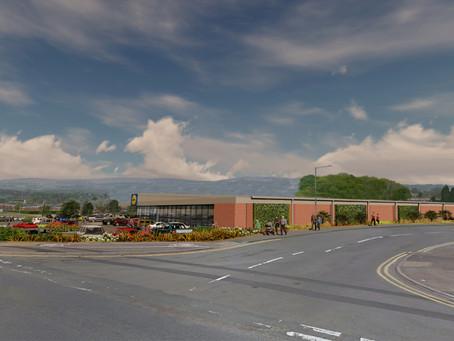 Eco supermarket design wins planning approval