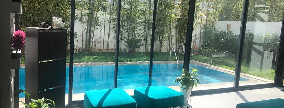 DAR BOUAZZA - Appartement 2 chambres en rez-de-chaussée avec jardin et piscine