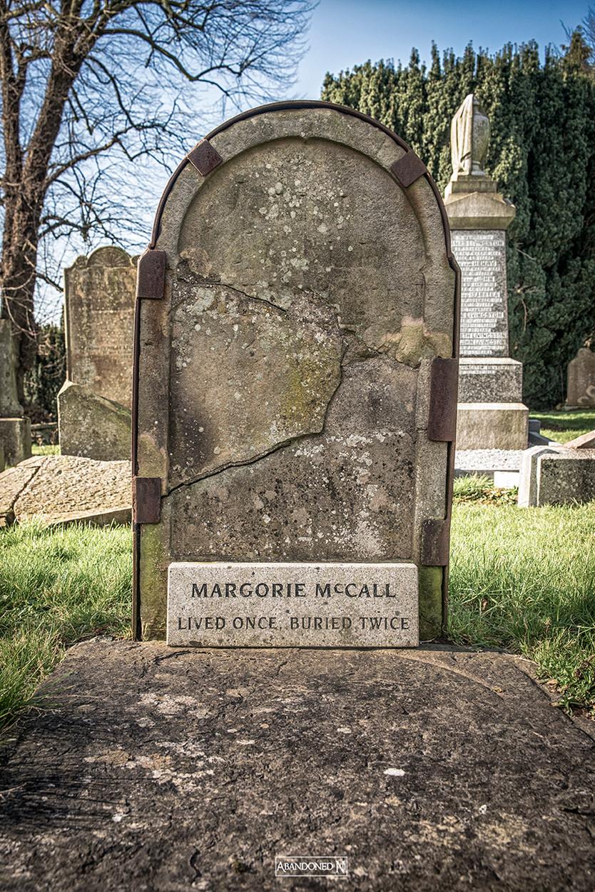 She lived once, was buried twice.