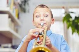 little-trumpeter-boy-playing-trumpet-hom