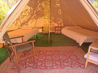 A peaceful night's sleep awaits you in our bell tents