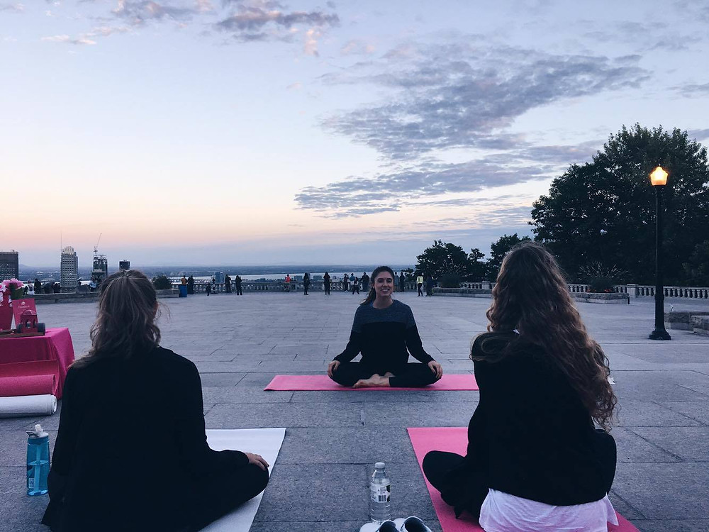 Yoga session on Mont Royal lookout Montreal