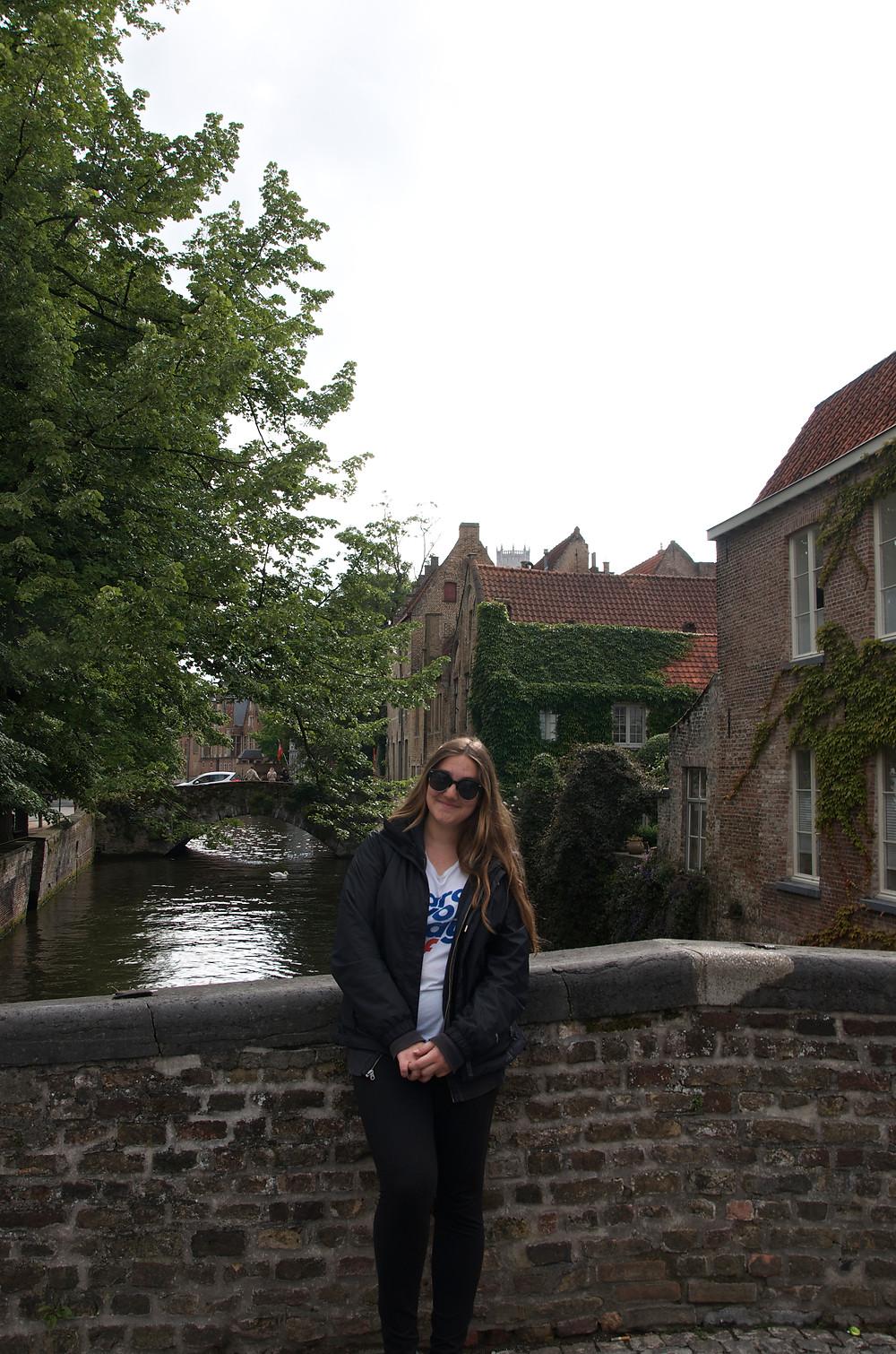 Girl on bridge in Bruges, Belgium