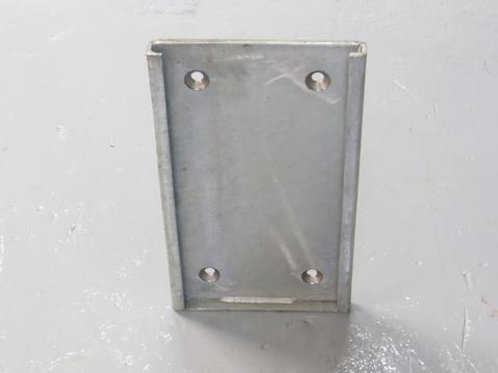 steel back plate on warehouse floor