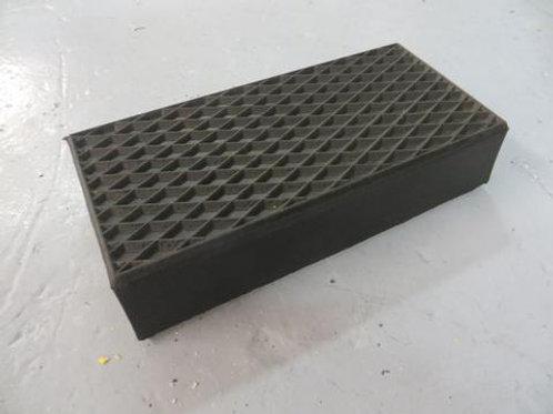 black rubber moulding on concrete floor