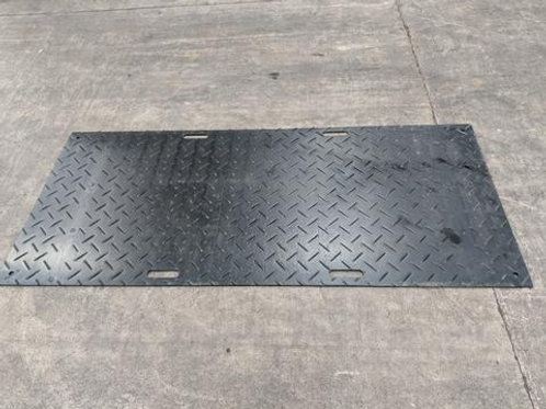 black rubber ground matting on a warehouse floor