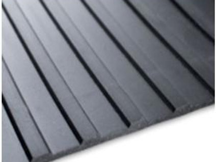 black rubber matting on wooden floor