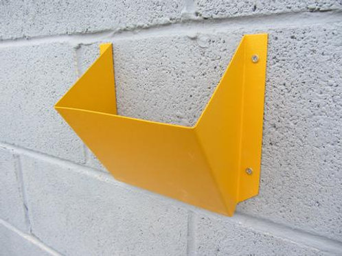 yellow wheel chock holder screwed on a concrete wall
