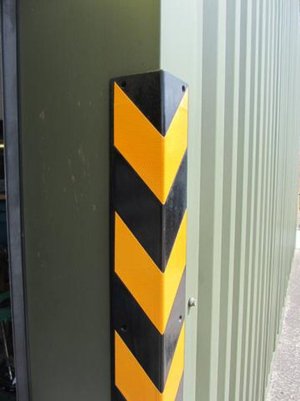 black and yellow chevron on green door