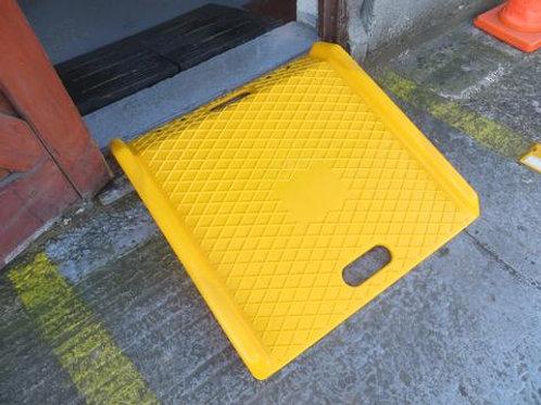 yellow kerb ramp outside