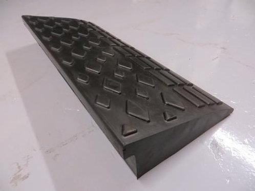 black rubber kerb on concrete floor