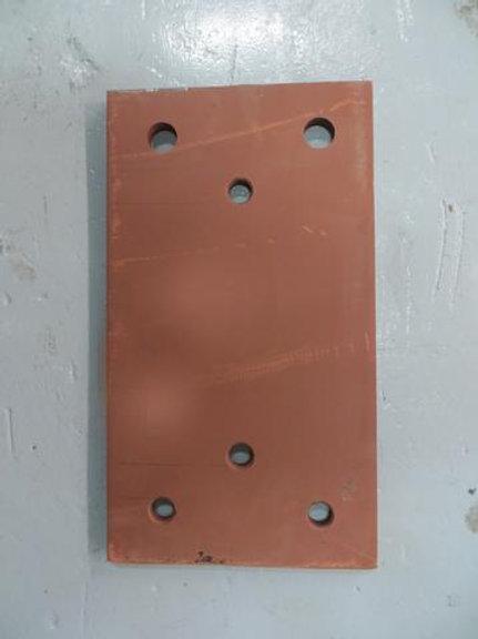 brown back plate on warehouse floor