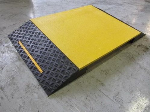 yellow and black hose and cable ramp on concrete floor