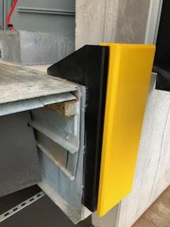 yellow dock bumper in a warehouse