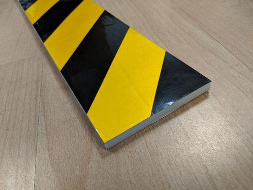 black and yellow foam edge on wooden floor