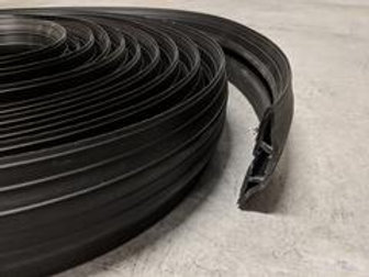 black rubber hose and cable ramp