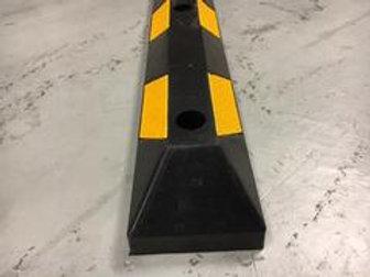 black and yellow chevron kerb on concrete floor