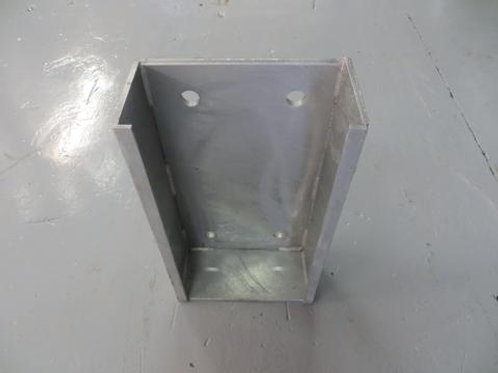 steel back plate on warehouse floor