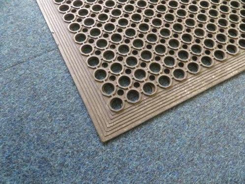 black rubber matting on a carpet floor