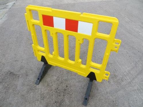 yellow barrier on concrete floor