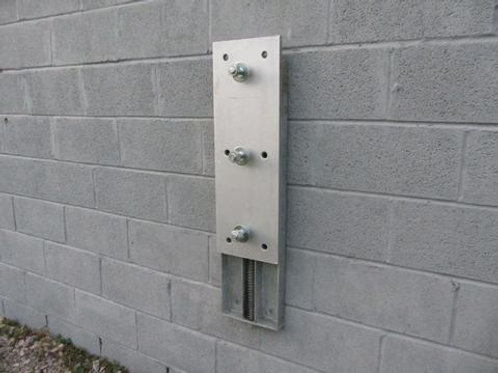 steel back plate on warehouse wall