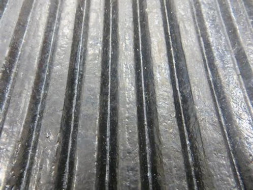 close up of black rubber matting