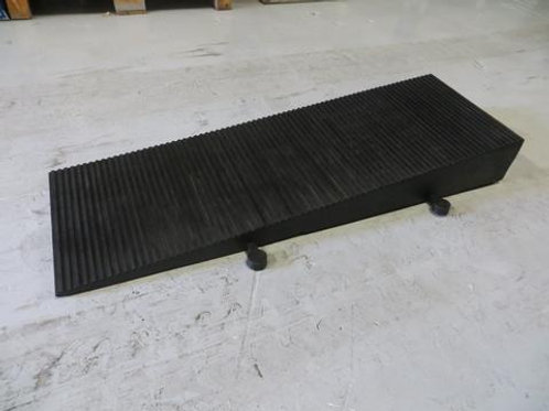 hose and cable ramp on concrete floor