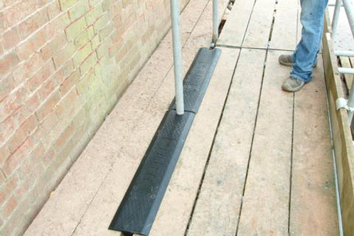 black rubber scaffolding filler on wooden base