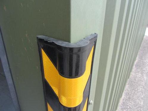 black yellow chevron corner protector on green door