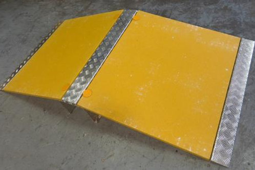 yellow hose and cable ramp on concrete floor