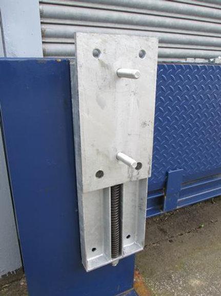 steel back plate on blue wall