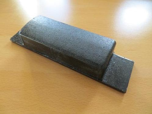 black rubber tipper pad on wooden floor