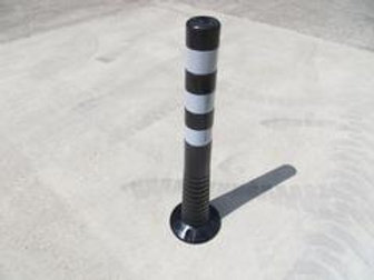 black bollard with white lines