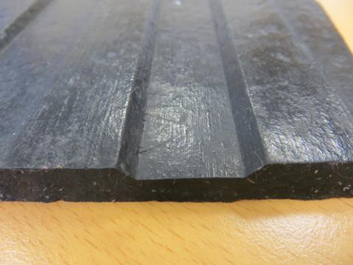 black rubber matting on wooden floor