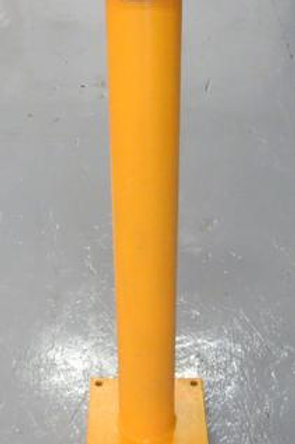 yellow bollard on warehouse floor