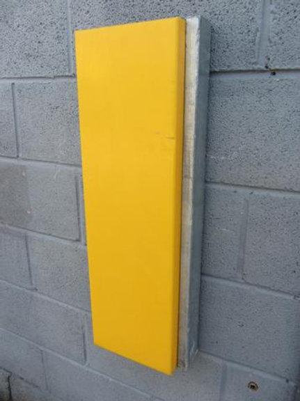 yellow dock bumper on blue brick wall