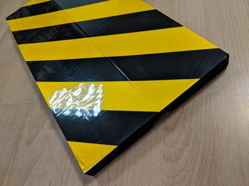 black and yellow chevron foam edging on wooden floor