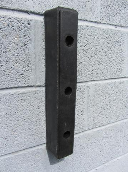 black dock rubber bumper on brick wall