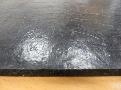 black rubber sheet on wooden floor