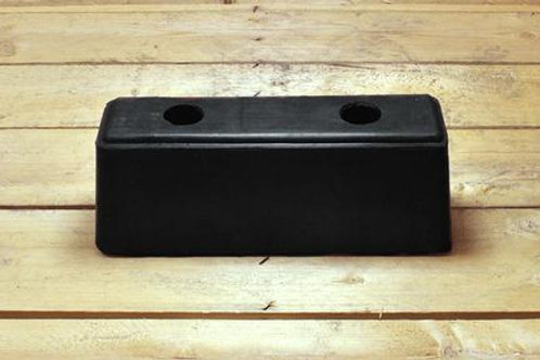 black rubber hgv bumper on wooden table