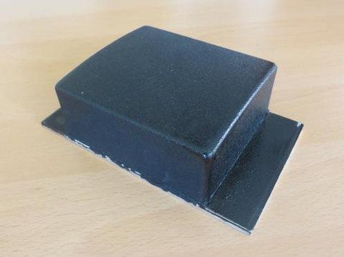 black tipper pad on a wooden floor