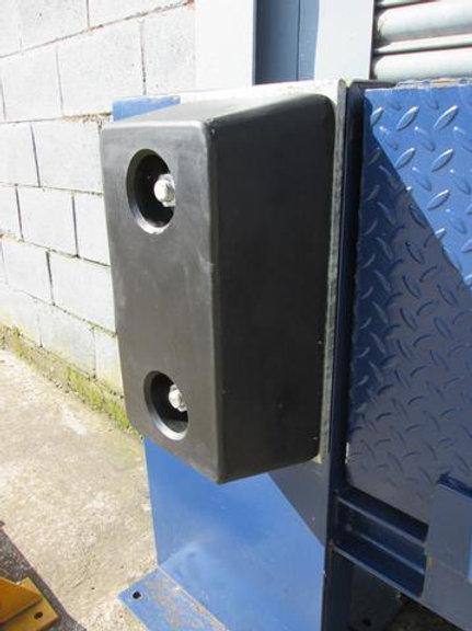 black rubber dock bumper on warehouse door