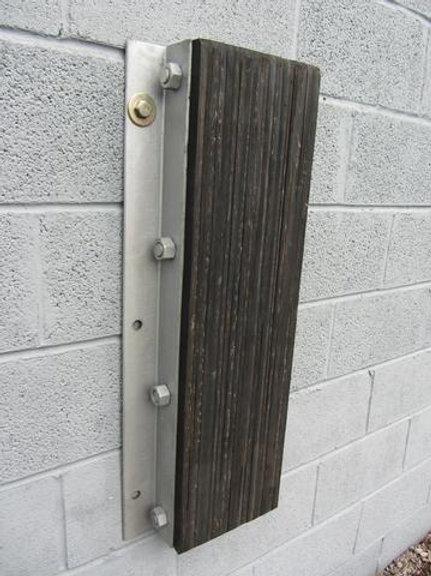 rubber dock bumper on brick wall