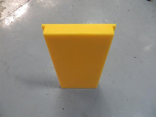 yellow front plate on factory floor